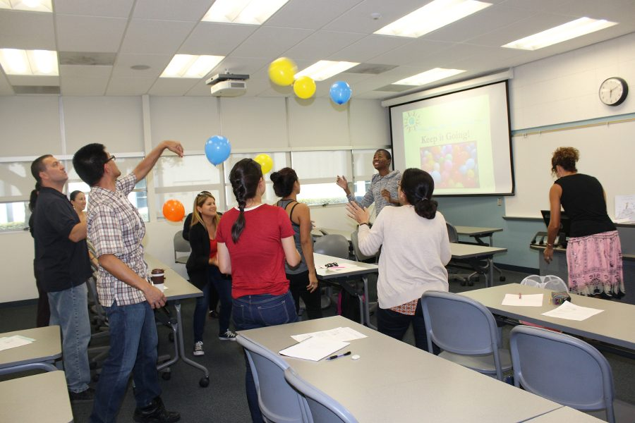 Students who were trying a new technique, by continually hitting the balloons up in the air. Each balloon was one of their many things students have on their mind all the time, and stressing them in their daily day life. Too many things and not enough time.   The workshop took place on Tuesday, September 27. Photo credit: Lizette Sainz