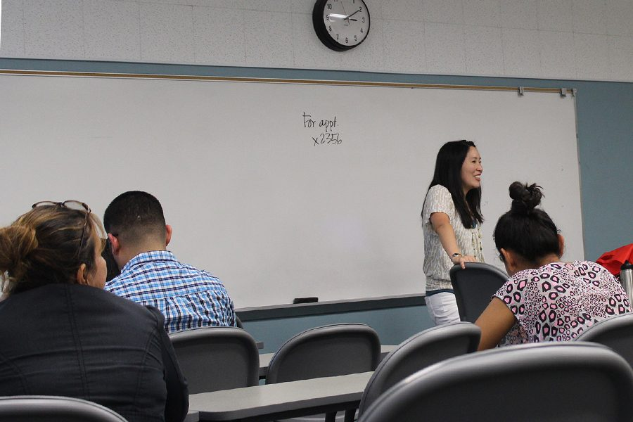 Career Services Counselor Traci Ukita, advises students on how to prepare for a job interview. Maria De La Rosa listens in on how to be well prepared. Photo credit: Leslie Castaneda