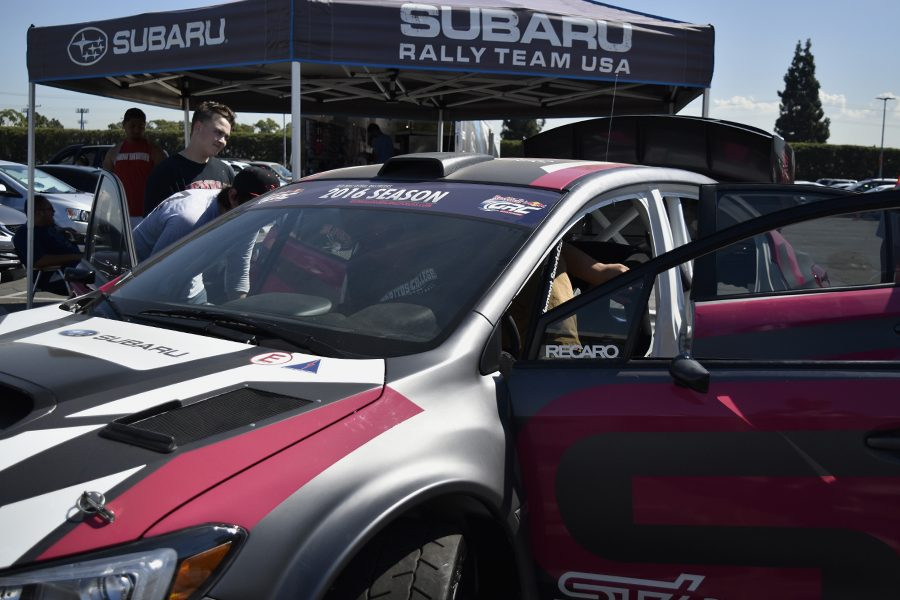 Justin+Surveyor+getting+inside+the+Subaru+Rally+Team+USA+car+on+Thursday%2C+Sept.+29.+The+Subaru+show+car+and+trailer+travel+to+about+80+different+events+per+year+but+according+to+Event+Manager+Nick+Alburger+the+goal+for+this+year+is+reaching+90+events.+Photo+credit%3A+Perla+Lara
