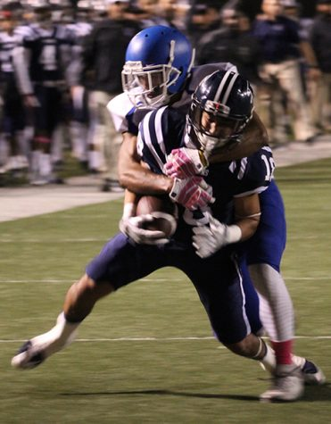 Wide receiver Matt Rosales fights for extra yardage after securing a pass from quarterback Nick Mitchell. Rosales finished the night with six receptions for 84 yards and a touchdown.