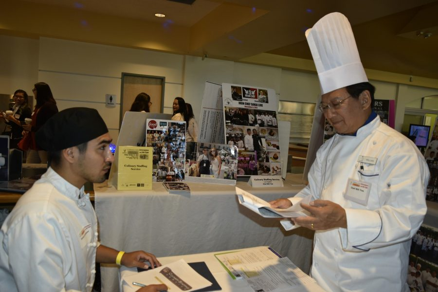 Culinary Staffing Recruiter Chef Bill Yee with Culinary arts major Erick Londono at the Culinary Arts Extravaganza and Job expo on Oct. 21 Yee's Culinary Staffing service was the only employer at the event that hired on the spot, Londono was one of the hires of the day. Photo credit: Briana Velarde