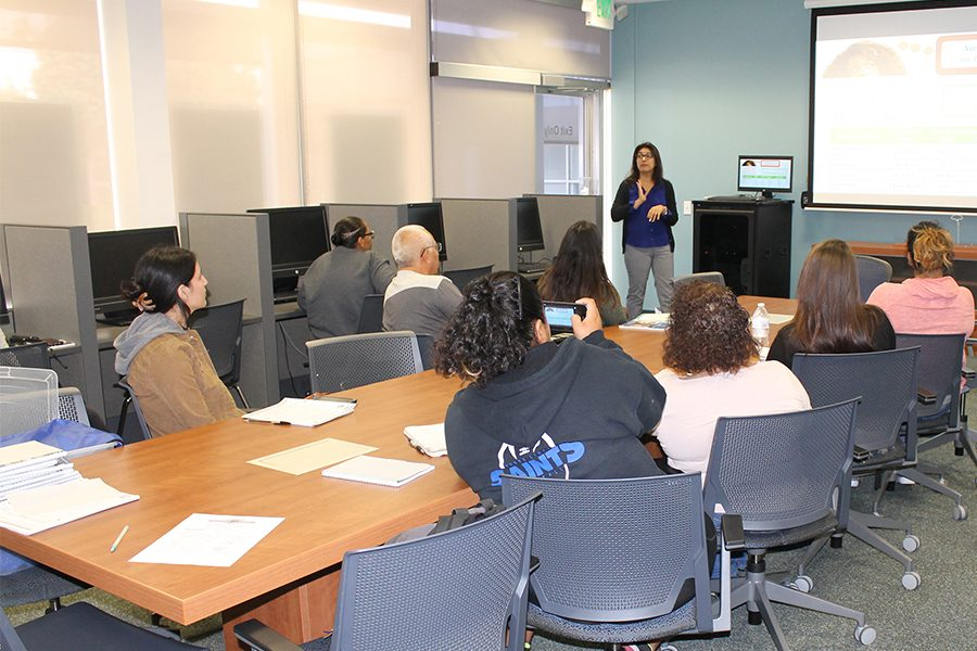 Students attended the Financial Aid workshop engaging with question they had on different types of students loans programs. Jenny Mejia presented the workshop that took place at the Financial Aid resource center on Wednesday, Sept. 12. She was able to provide as much possible information that could help students with financial resources at school. Photo credit: Lizette Sainz