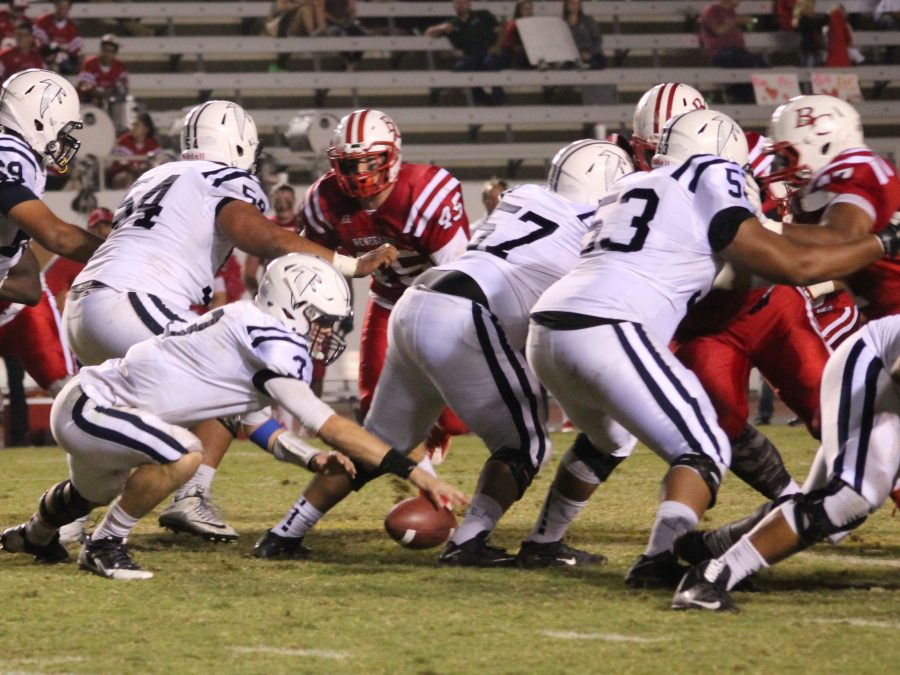 Quarterback Nick Mitchell suffers one of four fumbles during Cerritos' 28-21 loss to Bakersfield Saturday, Oct. 22. The Falcons were playing without their starting center Daniel Alanouf. Photo credit: Briana Hicks