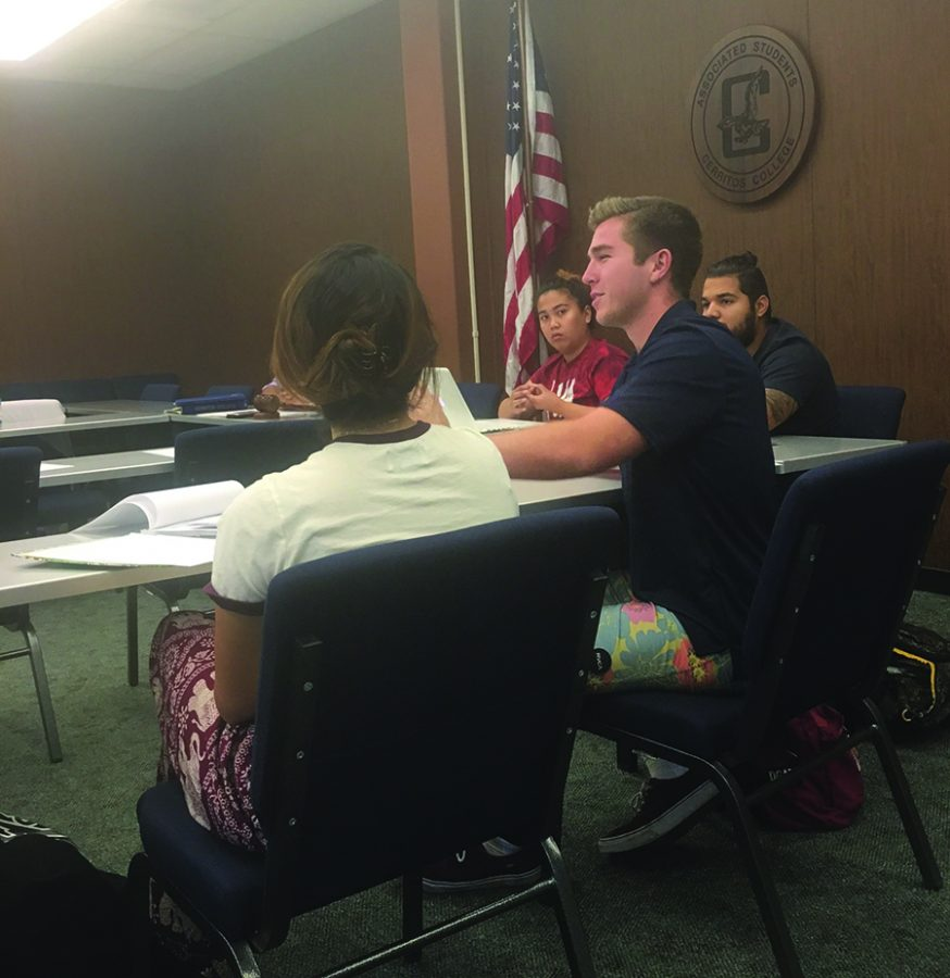ASCC commissioner of external affairs Connor Gafford explained to his fellow cabinet members how students would benefit from supporting Prop. 51. Gafford and ASCC President Saul Lopez united to gain support from cabinet on Prop. 51 and Prop. 55. Photo credit: Briana Hicks