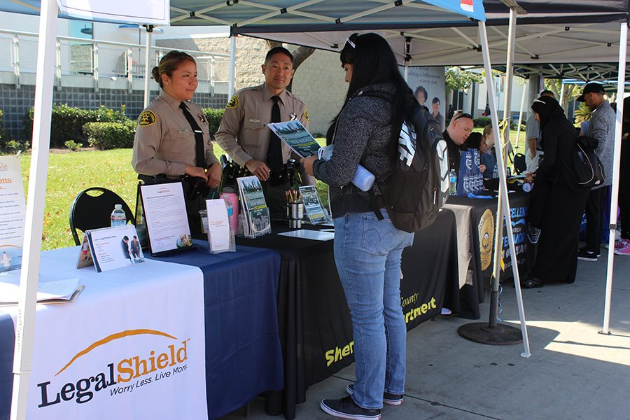 Deputy Sheriff Tiffany Park introduces students to unlimited opportunities to enter the Sheriff's Department. Karina Reyes, Accounting major, is interested in new ways to learn more.