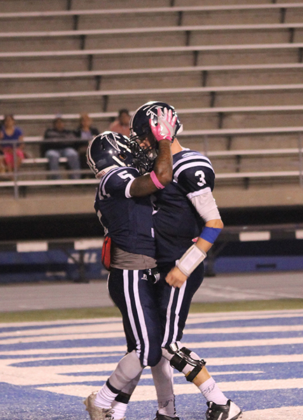Quarterback Nick Mitchell (No. 3) and running back Kishawn Holmes (No. 5) celebrate in the end zone during the homecoming game against Santa Monica. The 35-point outing set a new season-high for the Falcons.