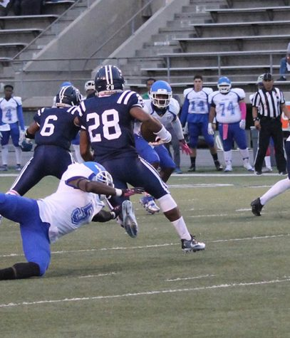 Running back Querale Hall scampers away from a Santa Monica defender during the homecoming game. Hall erupted for 86 yards on just six carries.