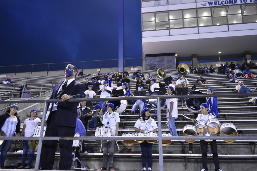 Dr. Betancourt leads the Pep Band in performing during this years homecoming game on Oct. 15. One responsibility of the band is to provide school spirit. Photo credit: Briana Velarde