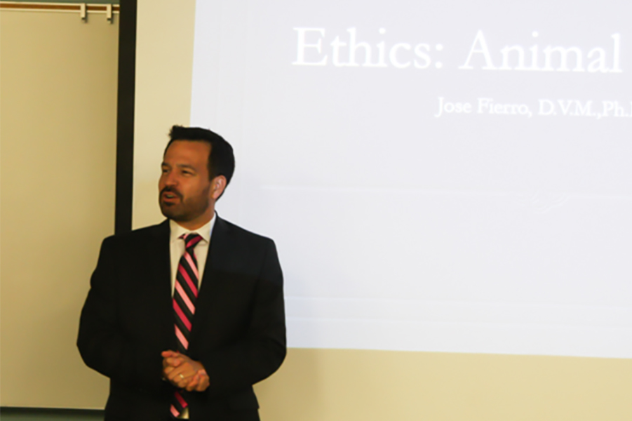 Cerritos College President Dr. Jose Fierro starting off his is presentation on Animal  testing and its ethics. He's speaking to about 45 people in attendance. Photo credit: David Jenkins