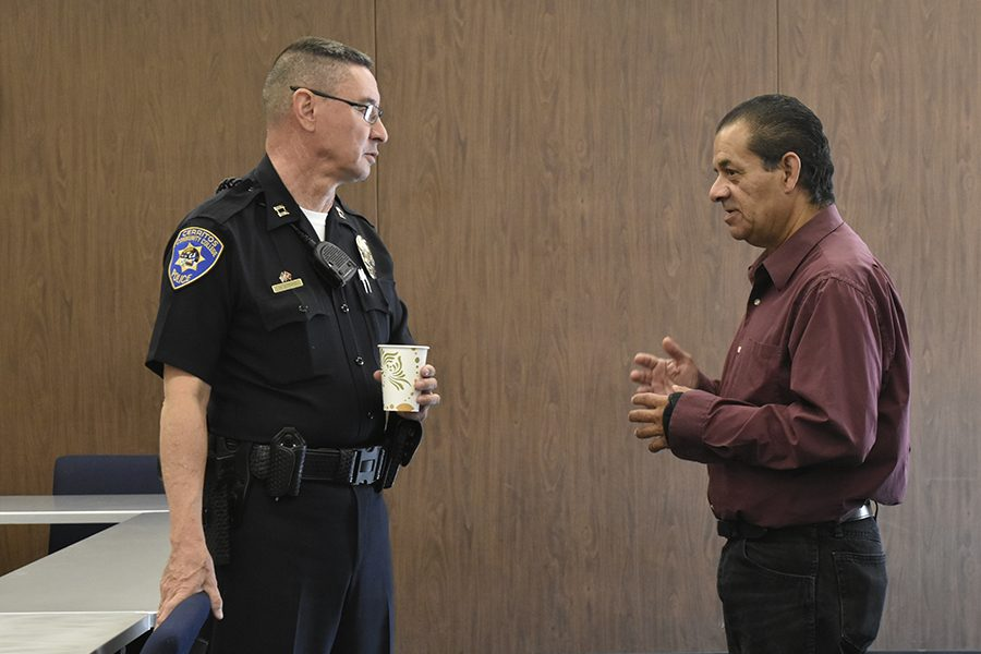 Cerritos College Police Captain Hans Strand speaking with Art major Ernest Sandoval during the Coffee with a Cop meeting on Thursday Nov. 3. Sandoval was seeking advice on what to do about a person possibly stalking him, Strand listen attentively as Sandoval described the different situations that involved a person approaching him in a challenging manner. Photo credit: Perla Lara