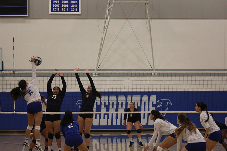 Outside hitter Nicole Flores skies for a kill against LA Harbor College in Cerritos season finale. That kill would be Flores only of the night.