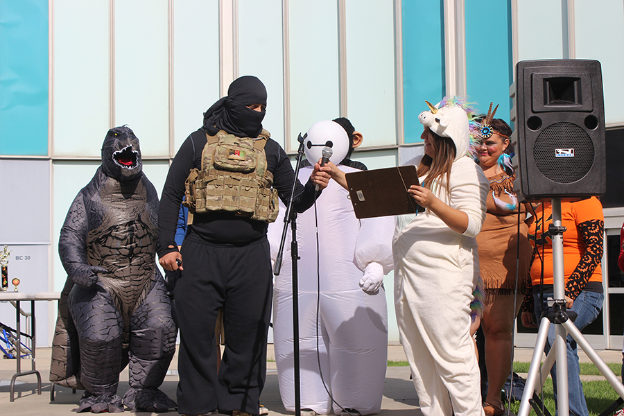 Enrique Rueda dressed as an ISIS terrorist and  Vanessa Vega dressed as a Unicorn for the Cerritos College Halloween costume contest. Once Rueda explained his costume he was disqualified and asked to leave the area. Photo credit: Chantal Romero