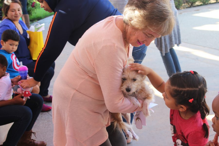 Bernice Lentons dog Patrick came outside to visit the kids. Lenton said she that her dog was surprisingly calm through the event and didnt bark at any of the kids. Photo credit: Terrel Emerson