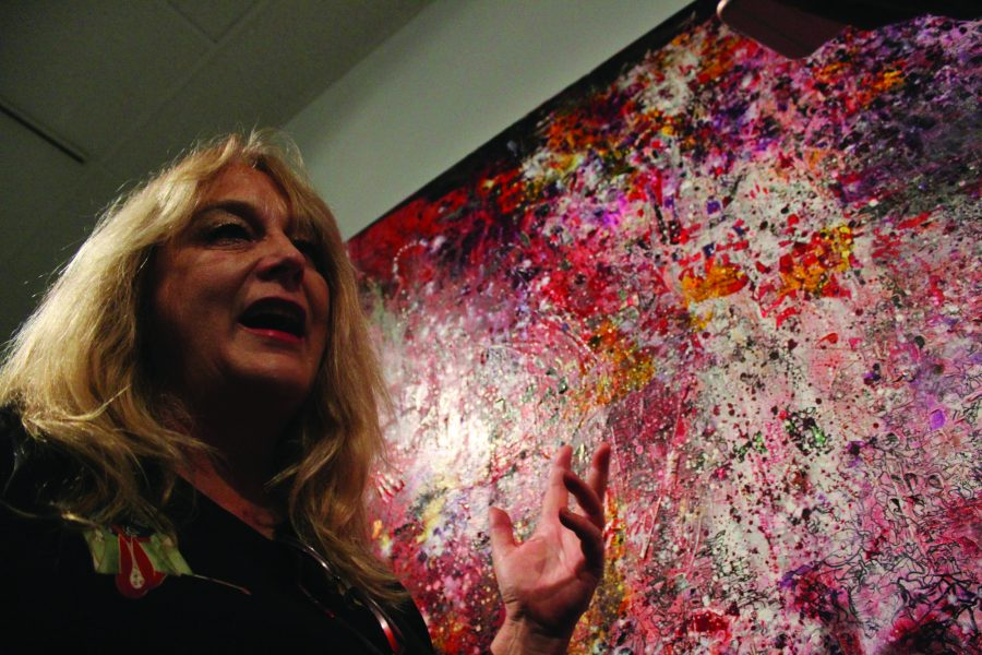 Christina McPhee discusses her art at the closing day of solo art show at the Cerritos College art gallery on Saturday, Nov. 12. McPhee's solo art show featured two series of work, Double Blind Studio Series and Second Sight.