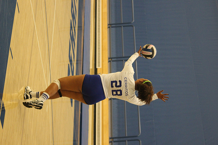 Right side hitter Abria Jones stands tall to deliver a serve over to LA Harbor College. Every player in uniform got a chance to play during the teams season finale win over the Seahawks.
