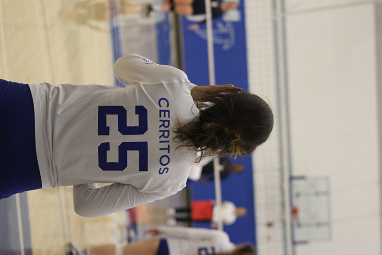 Right side Leslie Larranga stands patiently awaiting the sign before serving the ball to LA Harbor College. Larranga was one of eight sophomores, who celebrated Sophomore Night with a win.