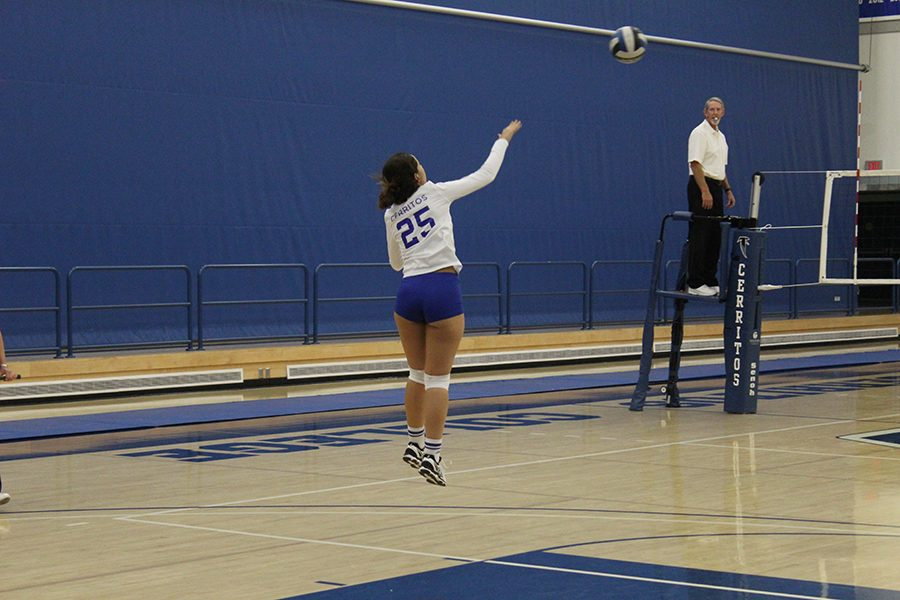 Right side Leslie Larranga skies high for a serve. The Falcons were able to beat the LA Harbor Seahawks in straight sets in the season finale.