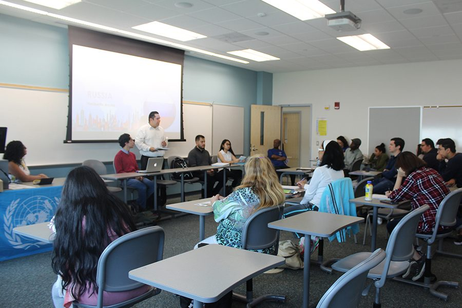 Model United Nations Simulation, students will simulate the Syrian regugee crisis in Europe  seeking solutions to this  crisis through dipolamtic  negotiations and for the presentation six students from the political science club were present, starting from the left side, major political science Nathaly A. Guerreo, major international business Carlos Diaz, major accounting Heriberto Arizona, mnajor political science Victor Ortiz, major political science Grethel Juanta. Photo credit: Lizette Sainz