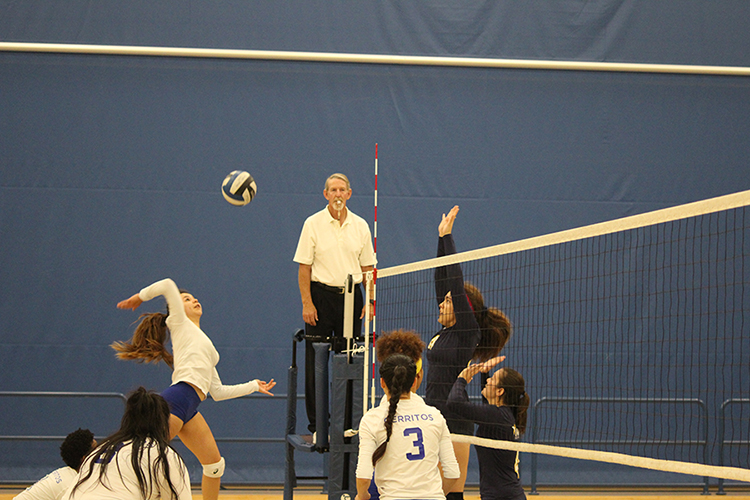 Outside hitter Monica Vega leaps in the air for a kill. She led the team with 17 kills on the night.