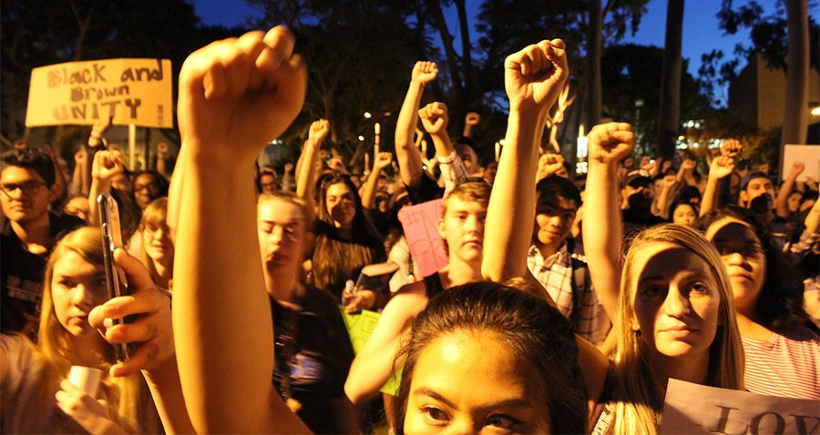 Speaker Yousef Baker instructed protestors to put their fist in the air and shout