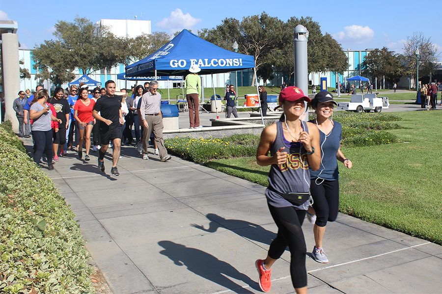 The turkey trot event took place at the Falcon square. Staff member from economy development Bellegran Gomez who's at the front left side.Falcon square. Photo credit: Lizette Sainz