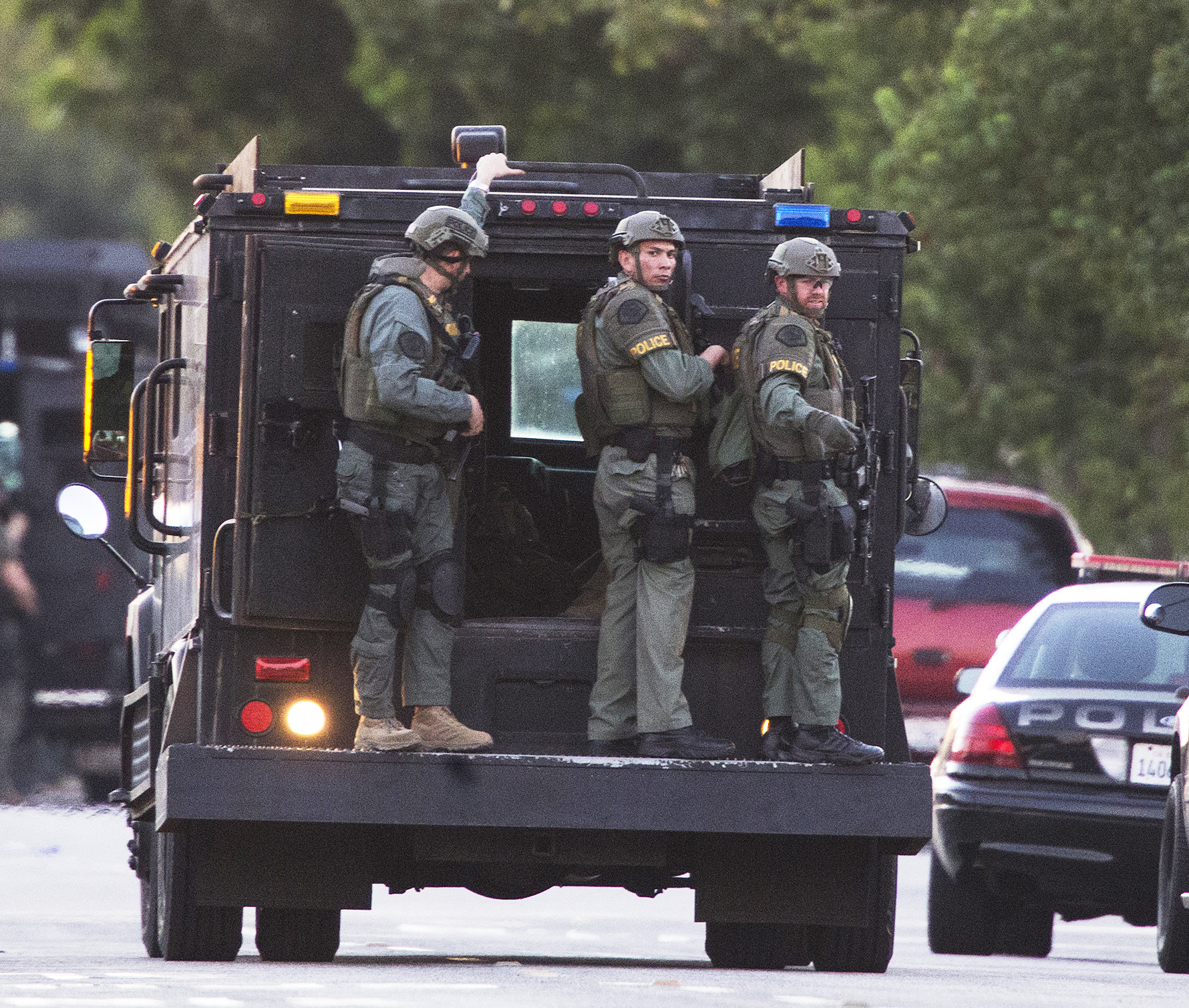 SWAT officers arrive on scene at the intersection of Orange Avenue and Fourth Street after 4 people were shot in Azusa, Calif., on Tuesday, Nov. 8, 2016. (Gina Ferazzi/Los Angeles Times/TNS)