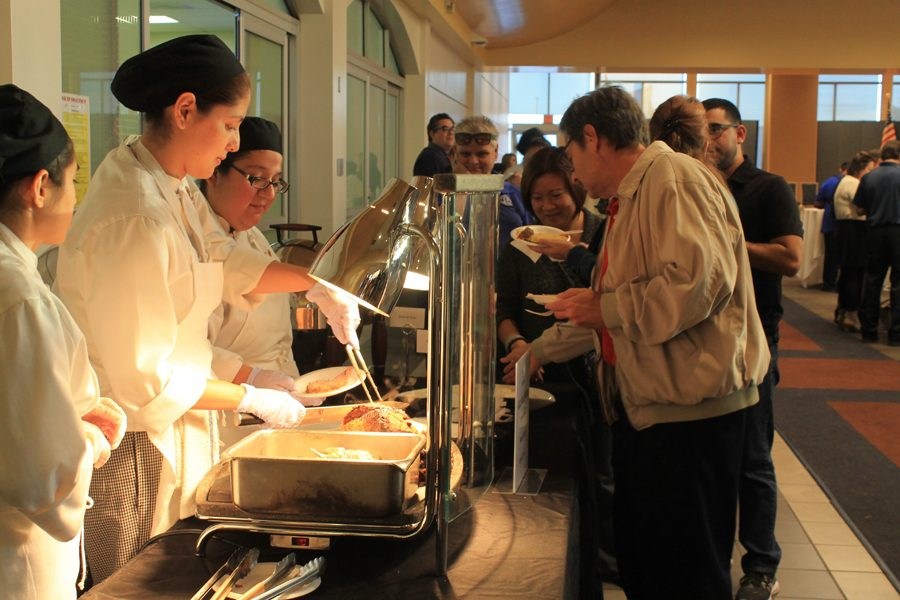 Culinart Arts student Stephanie Ruiz was one of the students in charge of the carving station at the President's Holiday Party, which took place on Thursday, Dec 8. The food's theme was Italian and included manicotti and lasagna.
