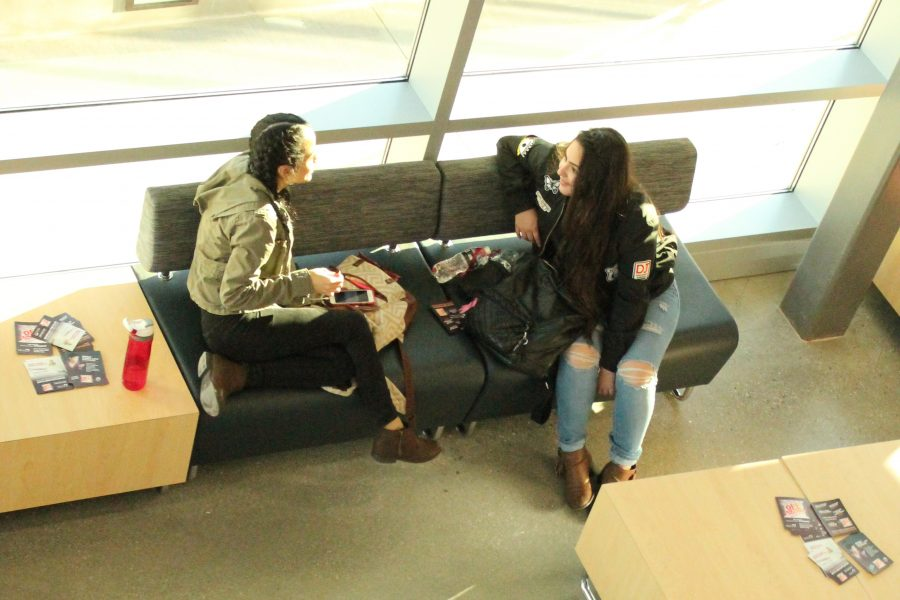 From right to left undecided major Cynthia Vega, and child development major Maricela Vargas enjoying time in the new fine arts building lobby.  The lobbies tables also has a electrical and usb outlets to charge portable devices. Photo credit: Perla Lara
