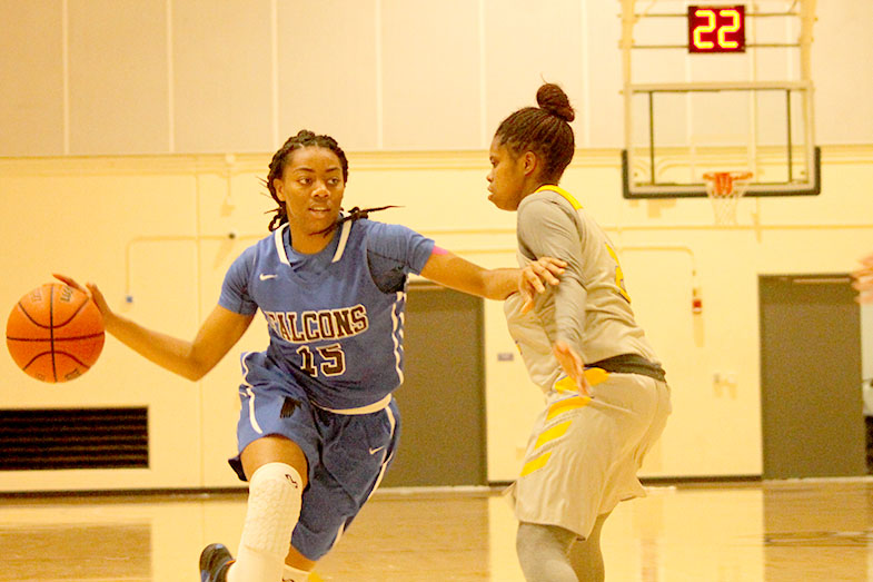 Freshman forward Alexis Clark blows by LA Southwest defender on way to the basket. The Falcons beat the Cougars 54-44. Photo credit: Max Perez