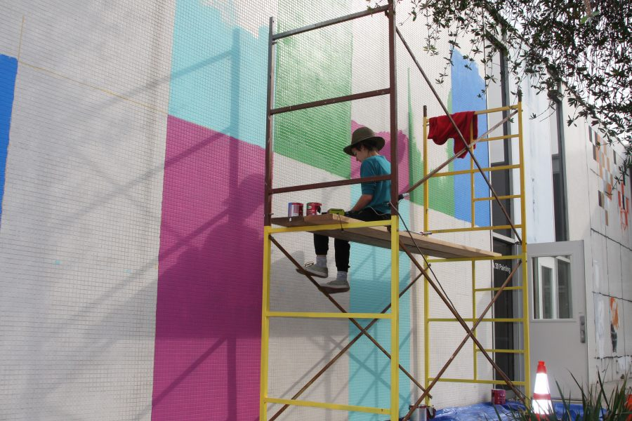 Yomina+Del+Castillo+painting+the+old+Fine+Ats+building.+The+community+will+be+able+to+paint+over+the+colorful+paint+at+the+FAR-Bazaar+event.+Photo+credit%3A+David+Jenkins