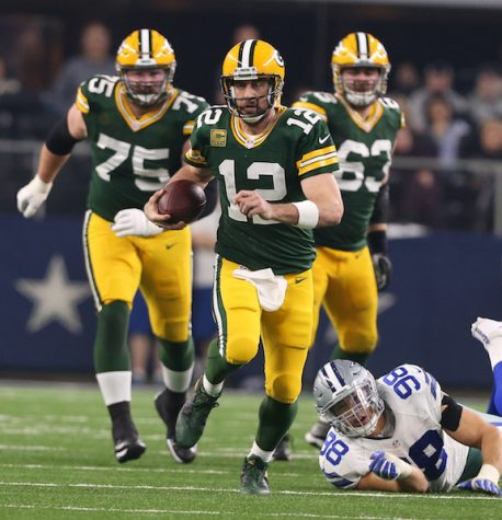 Green Bay Packers quarterback Aaron Rodgers (12) scrambles against the Dallas Cowboys in the NFL Divisional Playoff game on Sunday, Jan. 15, 2017 in AT&T Stadium in Arlington, Texas. (Richard W. Rodriguez/Fort Worth Star-Telegram/TNS)