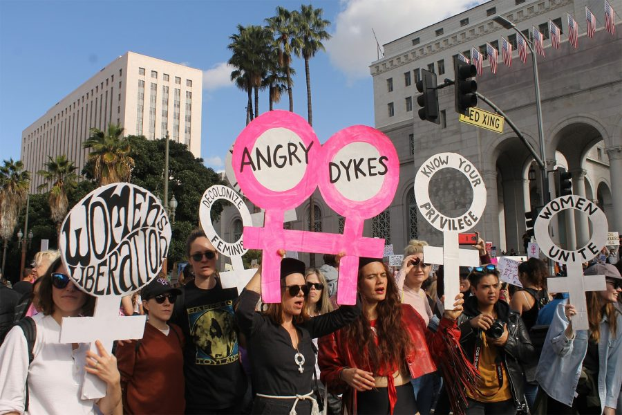 Men%2C+women+and+children+gathered+at+the+front+steps+of+city+hall+to+protest+against+President+Donald+Trump%E2%80%99s+inaguration.+The+protest+was+also+a+rally+for+equality+for+women+and+other+minority+groups.+Photo+credit%3A+Monique+Nethington