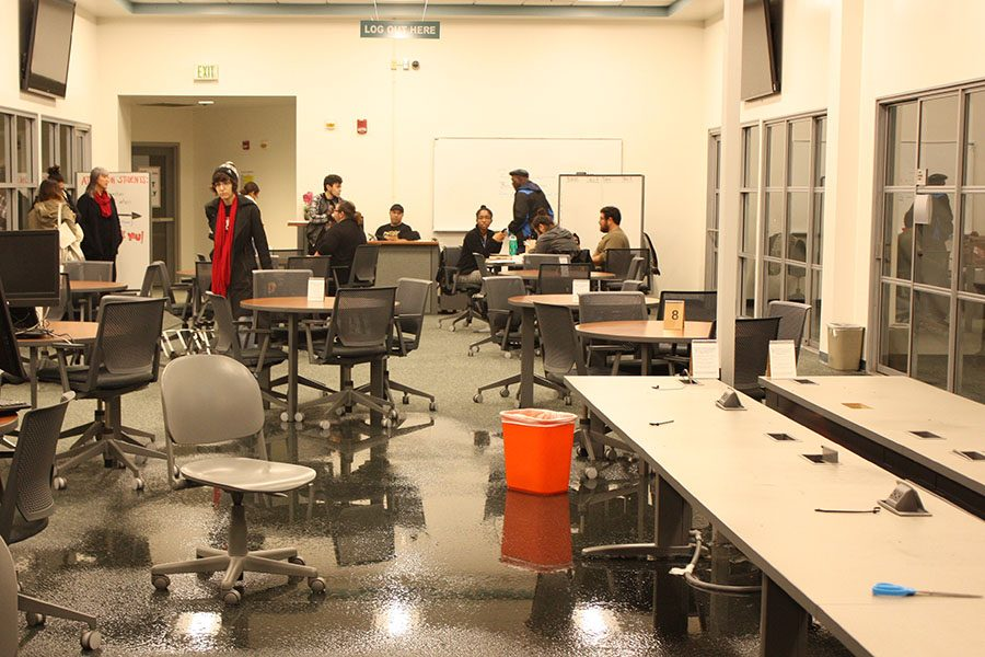 Students and Faculty look upon the flooded success center as the damage is assessed. The flooding occurred on the afternoon of Friday, Jan 20, 2017. Photo credit: Monique Nethington