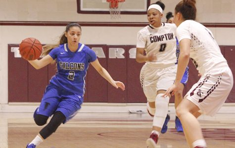 Freshman guard Angie Ferreira attempts to drive past EC-Compton defender. Ferreira would finish with 10 points and three assists in the victory over Compton.
