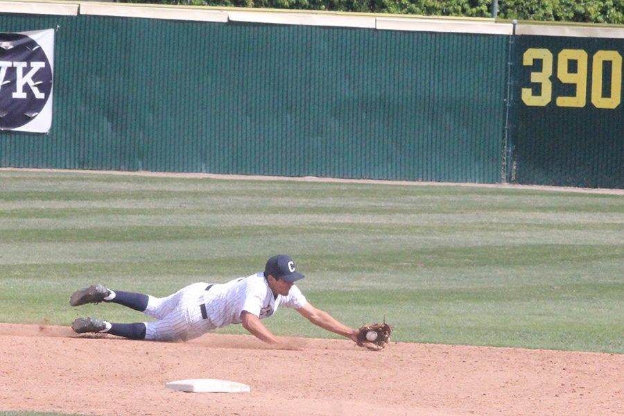 Shortstop Ramon Bramasco dives for a ground ball down the center of the field in the eight inning of the Falcons game with El Camino Saturday. Bramasco finished the game with one hit in the loss to El Camino Photo credit: Max Perez