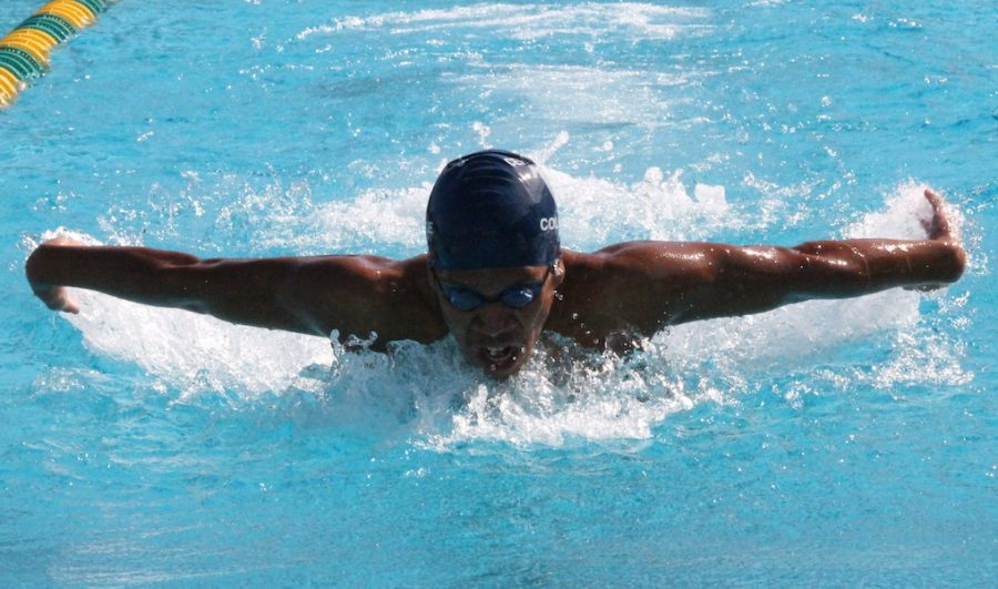 Sophomore swimmer Isiah Gaytan mid stroke during the third heat of the 100-yard butterfly at the Golden West Invitational. Gaytan would not place in the 100-yard butterfly but would finish the invitational with an eighth place finish in the 500-yard freestyle. Photo credit: Max Perez