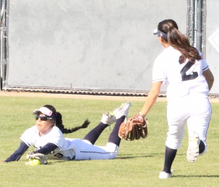 Sophomore+outfielder+Kimberly+Olivas+makes+a+diving+catch+in+the+top+of+the+first+inning+for+the+third+out+of+the+inning.+Olivas+finished+the+game+with+two+hits%2C+three+runs+and+one+RBI+in+the+Falcons+win+over+Rio+Hondo.+Photo+credit%3A+Max+Perez