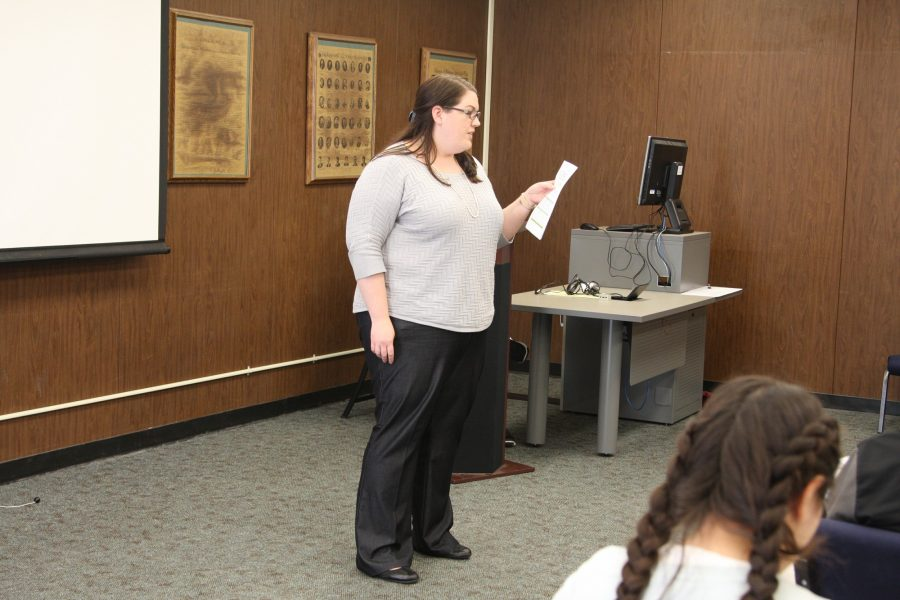 Dean of Student Services Elizabeth Miller discusses legislation to approve two large digital screens for the audience to view graduating students at commencement ceremony. The funds were approved for $27,000. Photo credit: David Jenkins