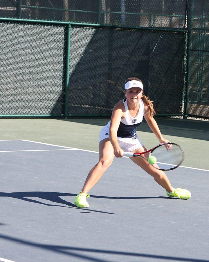 Freshman+Petra+Such+swings+at+a+ball+during+the+women%27s+matches+with+McPherson+College.+The+Falcons+won+only+one+singles+match+the+entire+day.+Photo+credit%3A+David+Jenkins