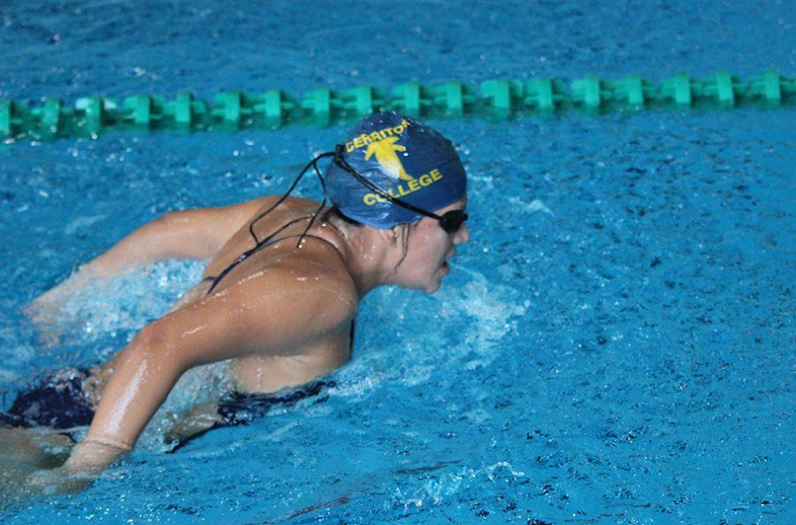 Freshman+Adriana+Ross+mid+stroke+during+the+200-yard+breaststroke+at+East+Los+Angeles+College+Friday%2C+March+24.+The+women+would+lose+to+ELAC+and+Pasadena+City+College+at+the+conference+meet.+Photo+credit%3A+Michael+Cueto