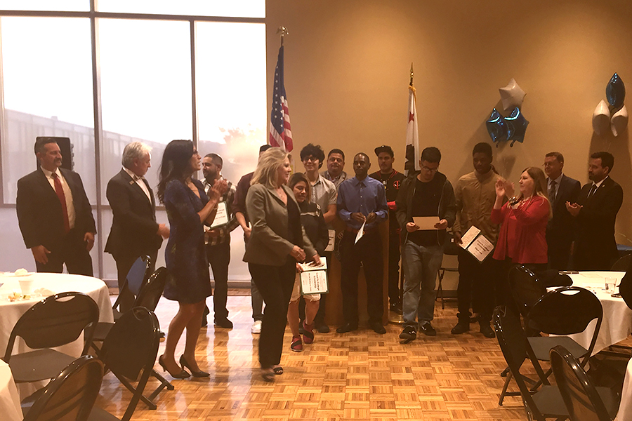 (from left) Judge Peter Espinoza, Cerritos College Counselor MiaSarah Cesena, Probation Officer Jennifer Salverson and students celebrate the scholarship recipients on Thursday, April 6. Nine students were awarded scholarships that ranged from $250-$750 dollars.