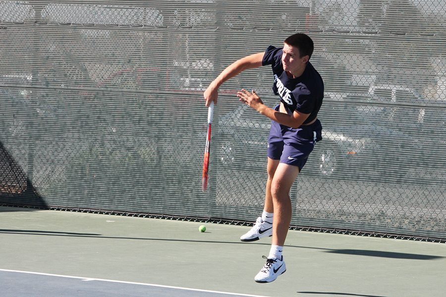 Sophomore+Nikita+Katsnelson+follows+through+a+swing+during+his+singles+match+Friday%2C+March+31+against+Mesa+Ariz.+College.+Katsnselson+won+his+singles+and+doubles+match.+