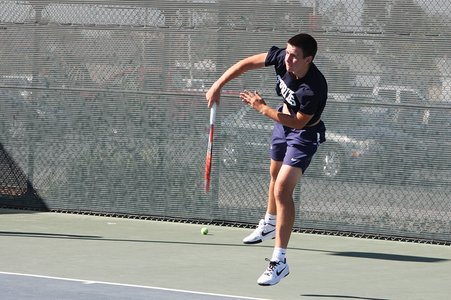 Sophomore Nikita Katsnelson follows through a swing during his singles match Friday, March 31 against Mesa Ariz. College. Katsnselson won his singles and doubles match.