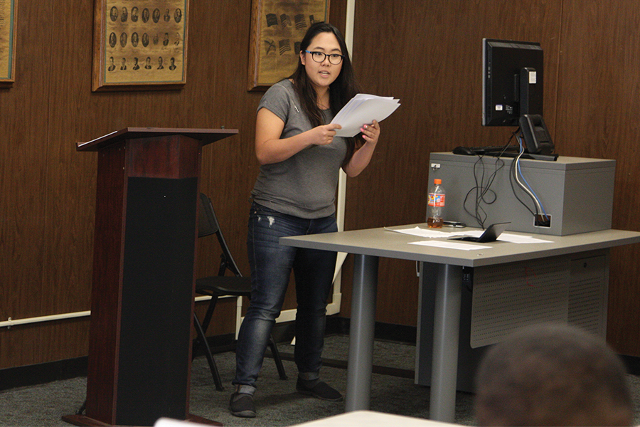 "Homecoming Queen Megn Kim passes out her ""New Commissioner position"" legeslation proposal to oth ASCC senate and to the public. She was able to get majority vote and get it passed."
