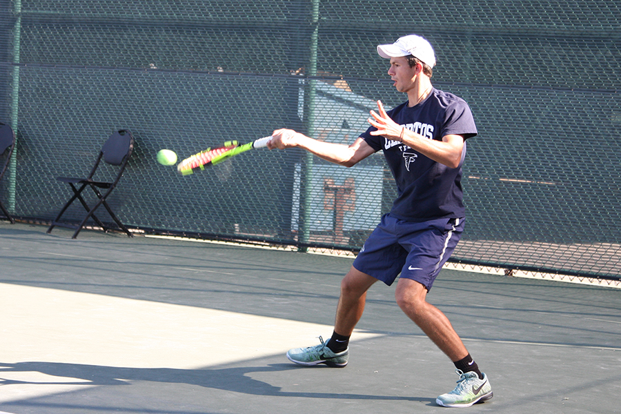 Sophomore Sasha Krasnov returns a ball during his match Friday, March 31 against Mesa Ariz. College. Krasnov would win his singles match as well as his doubles match paired with Nikita Katsnelson.