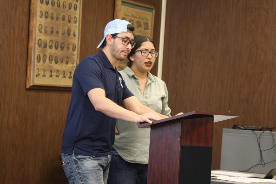 ASCC Senator David Ramirez and Student Trustee Karen Patron discuss the updates for funds students who go on school trips use. The students receive a designated amount of $42 for meals per day, but must turn in receipts to continue to receive money. Photo credit: David Jenkins