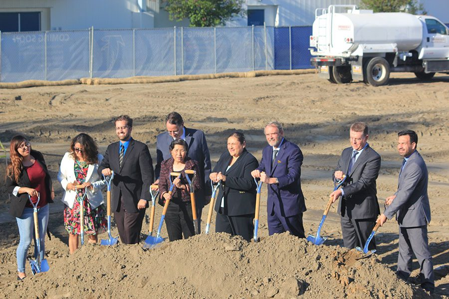Members of the Cerritos College Board of Trustees, Student Trustee Karen Patron, Dr. Jose Fierro and Dean of Athletics Dan Smith gather on together at the site of the Health and Wellness Complex. The new building is set to be complete in June 2020. Photo credit: Max Perez