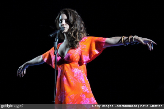 INDIO, CA - APRIL 13:  Singer Lana Del Rey performs onstage during day 3 of the 2014 Coachella Valley Music & Arts Festival at the Empire Polo Club on April 13, 2014 in Indio, California.  (Photo by Katie Stratton/Getty Images for Coachella)