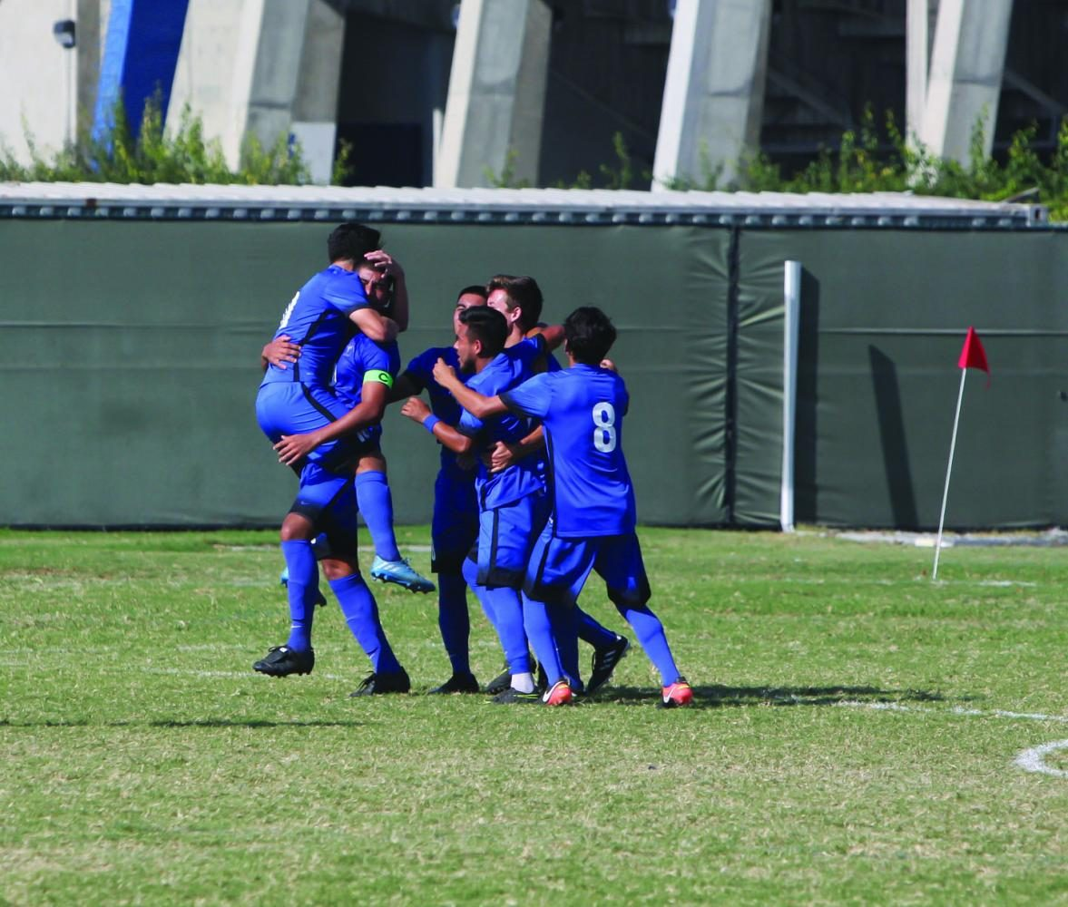 The Falcon's celebrate their first goal of the game. The goal was made by Esteban Camacho with the help of Luis Garcia's free kick. The Falcon's won the game 4-0. Photo credit: David Jenkins