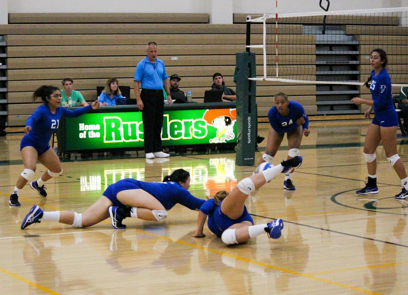 Cerritos College freshman #17 Jody Suski and freshman #4 Nataly Reynoso both dive after a ball during Friday's game against Golden West. The Falcons were swept by the Rustlers in 3 games. Photo credit: Lindsay Helberg